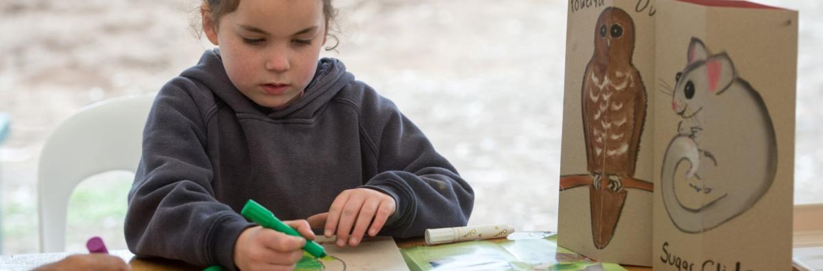 Girl Drawing Animals at Tree Planting Event