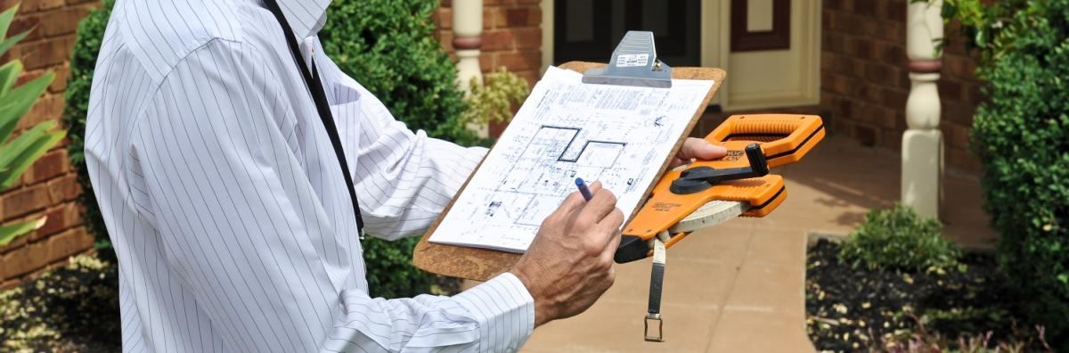 Man with Building Planning Clipboard