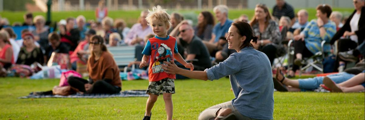 Mother and Child on Grass at Event