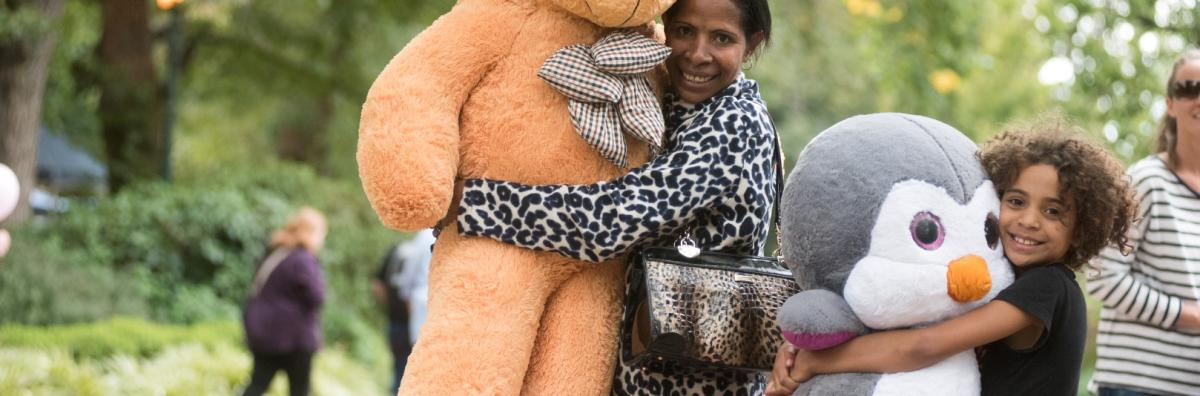 Women with giant teddies