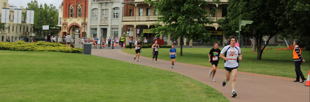 A group of joggers completing a Fun Run in Rosalind Park
