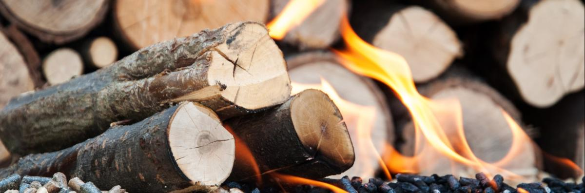 Logs and pellets on fire