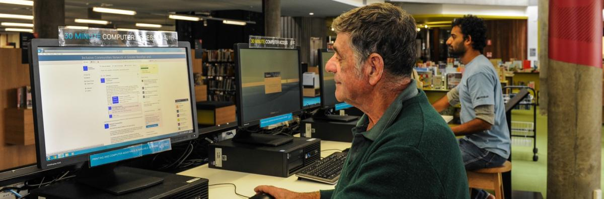 Man on computer at Library
