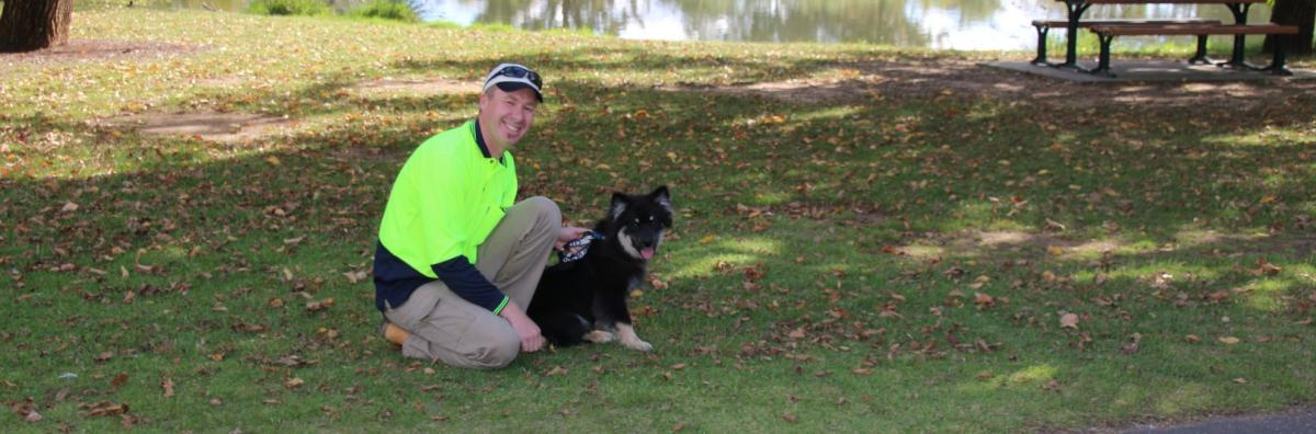A photo of an animal services ranger with a dog at Lake Weeroona