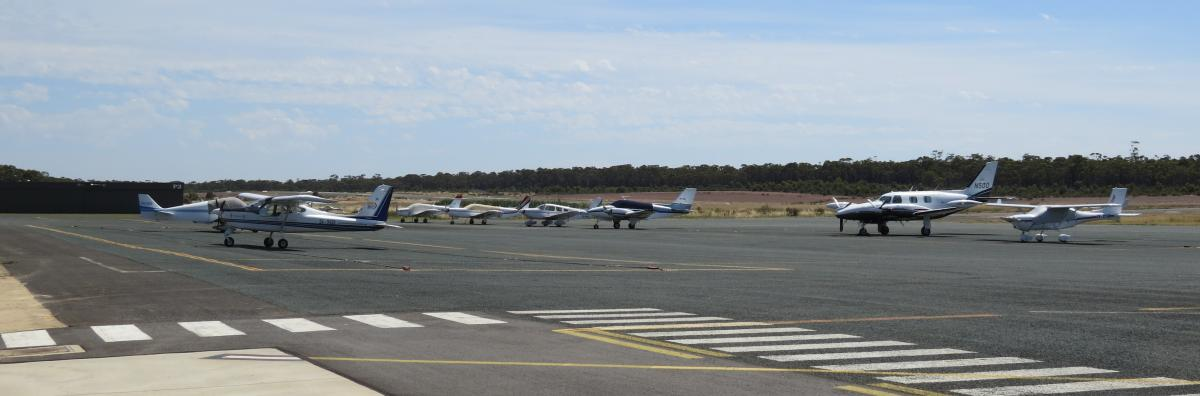 A group of 7 small aircraft parked at Bendigo Airport