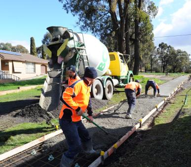 Staff Shoveling Concrete onto New Footpath