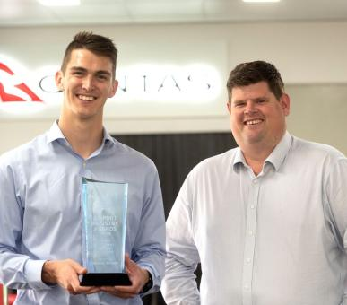Scott Woodman and Andrew McCulloch holding the small regional  airport of the year award from the Australian Airports Association Annual Industry Awards