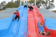 Kids on New Slides at Park