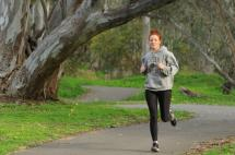 Woman Running in Spring Gully Reserve