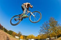 BMX bike jumping in air